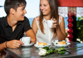 Young couple drinking coffee on romantic anniversary date.